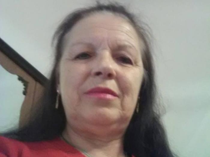 Femeie de 56 de ani)